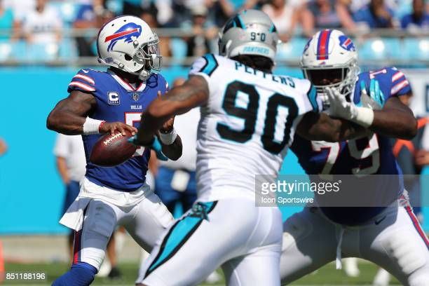 Buffalo Bills offensive tackle Dion Dawkins fends off Carolina Panthers defensive end Julius Peppers as quarterback Tyrod Taylor looks to pass during...