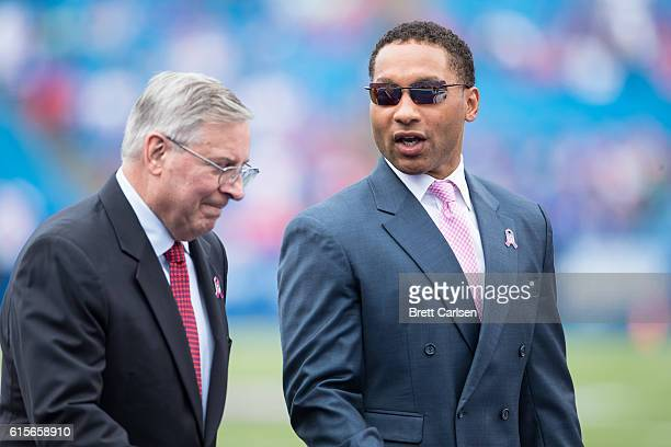 Buffalo Bills owner Terry Pegula and Buffalo Bills general manager Doug Whaley walk the field before the game before the Buffalo Bills and the San...