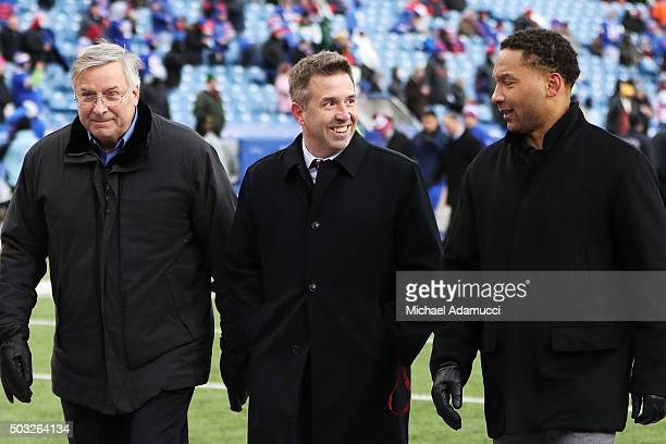 Buffalo Bills owner Terry Pegula Buffalo Bills president Russ Brandon and Buffalo Bills general manager Doug Whaley walk off the field before the...