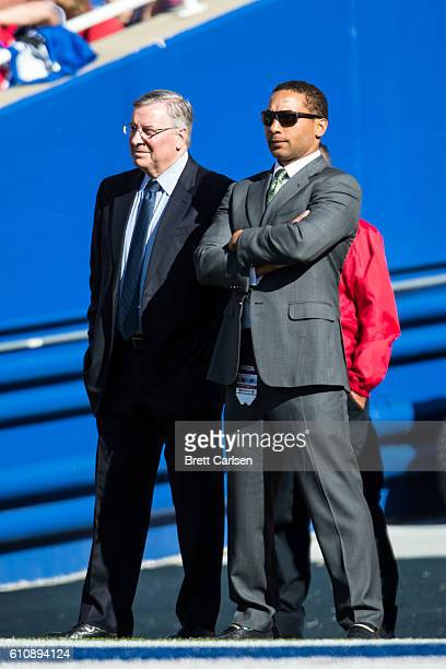 Buffalo Bills owner Terry Pegula watches the game against the Arizona Cardinals with General Manager Doug Whaley during the second half at New Era...