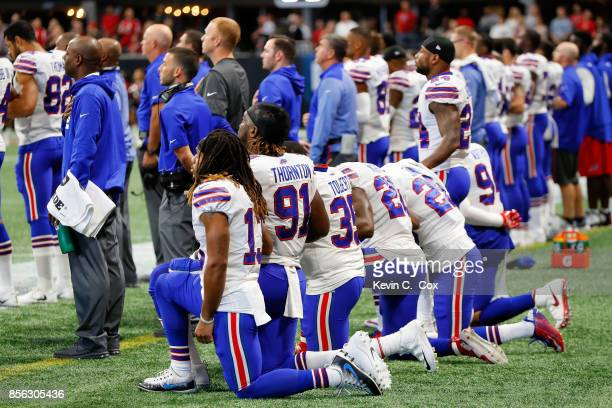 Buffalo Bills players kneel during the national anthem prior to the first half against the Atlanta Falcons at MercedesBenz Stadium on October 1 2017...