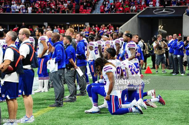 Buffalo Bills players kneel during the national anthem prior to the game against the Atlanta Falcons at MercedesBenz Stadium on October 1 2017 in...