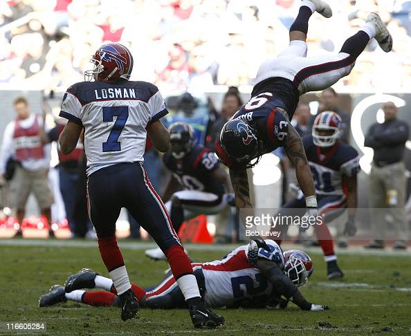 Buffalo Bills quarterback JP Losman looks down field for a receiver as Buffalo Bills running back Anthony Thomas blocks Houston Texans defensive end...