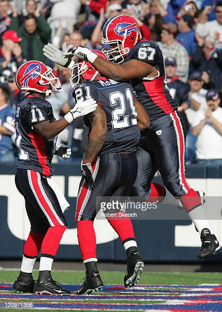 Buffalo Bills running back Willis McGahee celebrates his TD with teammates Roscoe Parrish and Melvin Fowler during game between the Buffalo Bills and...