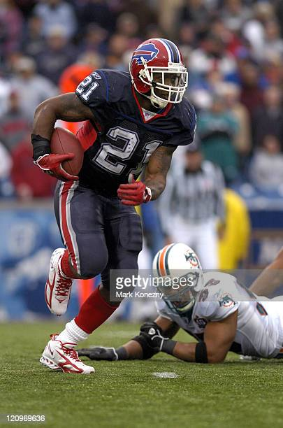 Buffalo Bills running back Willis McGahee runs for yardage during a game against the Miami Dolphins at Ralph Wilson Stadium in Orchard Park New York...