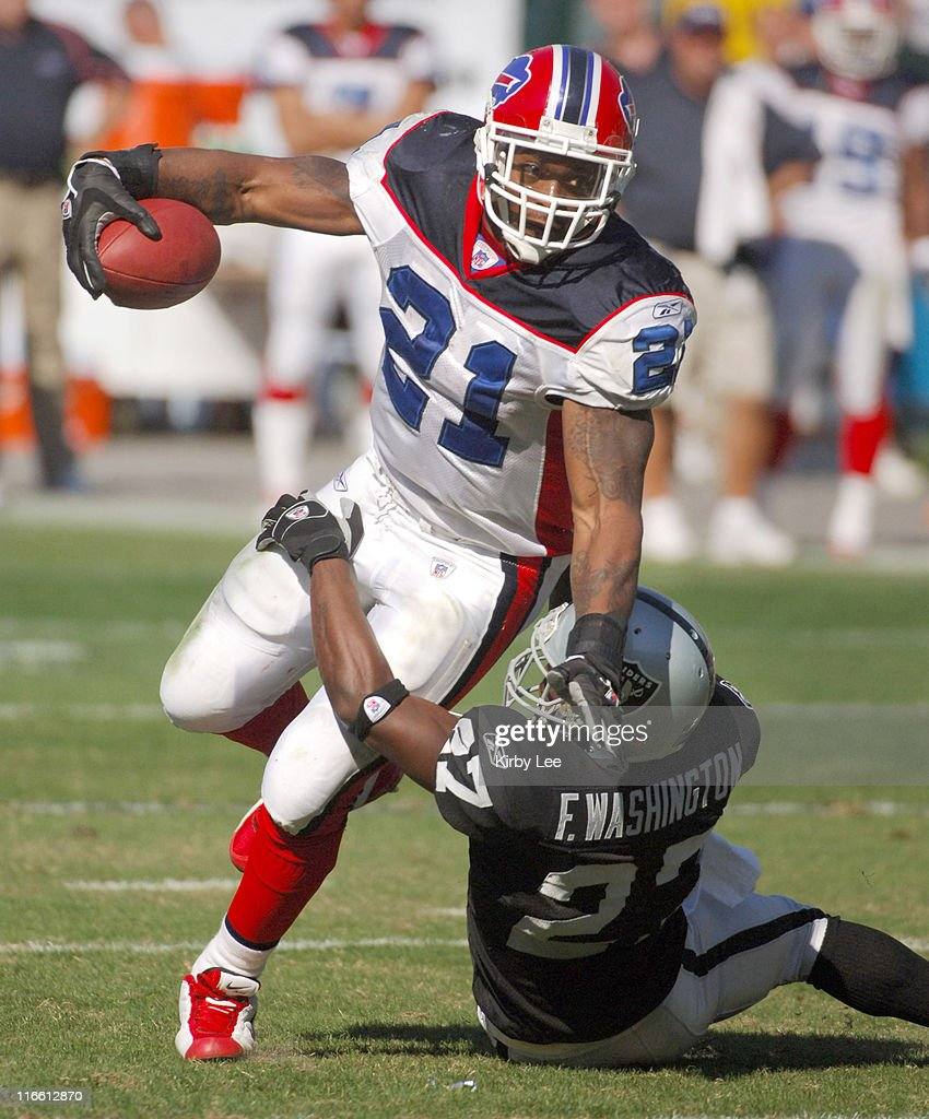 Buffalo Bills running back <a gi-track='captionPersonalityLinkClicked' href=/galleries/search?phrase=Willis+McGahee&family=editorial&specificpeople=202895 ng-click='$event.stopPropagation()'>Willis McGahee</a> tries to break free from grasp of Oakland Raiders rookie cornerback <a gi-track='captionPersonalityLinkClicked' href=/galleries/search?phrase=Fabian+Washington&family=editorial&specificpeople=748828 ng-click='$event.stopPropagation()'>Fabian Washington</a> during 38-17 loss at McAfee Coliseum in Oakland, Calif. on Sunday, October 23, 2005.