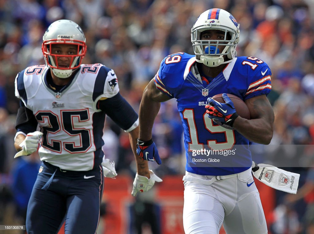 Buffalo Bills wide receiver Donald Jones (#19) leaves New England Patriots free safety Patrick Chung (#25) in his wake as he runs a 68-yard pass reception for a third quarter Buffalo touchdown as the Patriots took on the Buffalo Bills at Ralph Wilson Stadium.