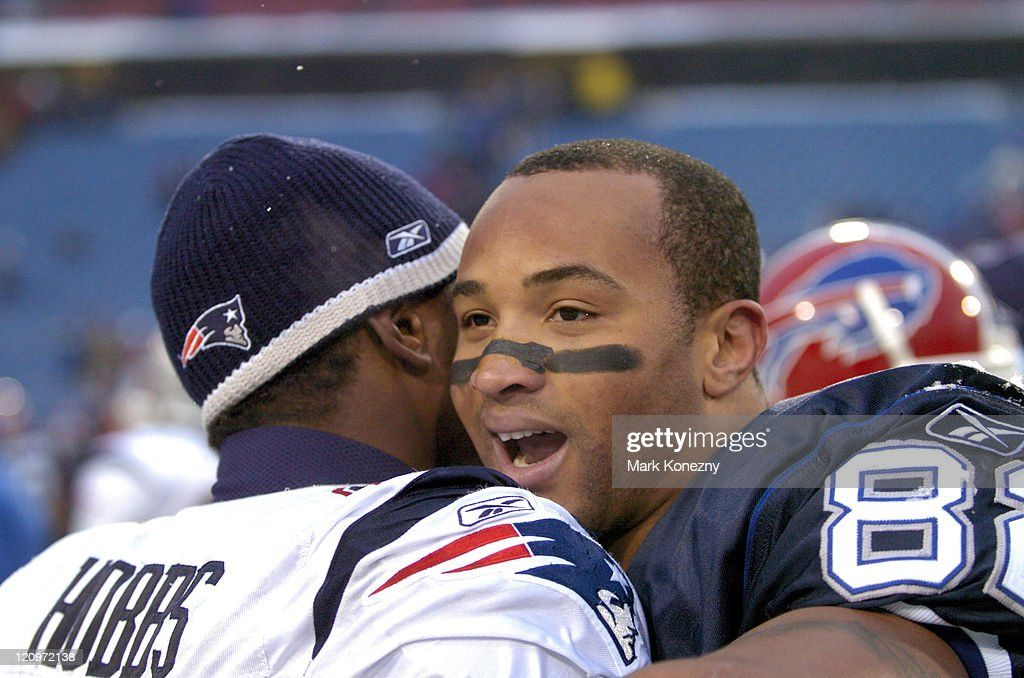 Buffalo Bills wide receiver Josh Reed and New England Patriots defensive back Ellis Hobbs meet at midfield after a game at Ralph Wilson Stadium in...