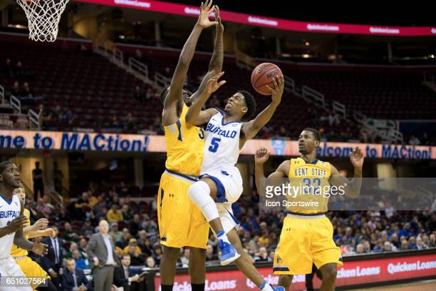 Buffalo Bulls G CJ Massinburg drives to the basket as Kent State Golden Flashes F Jimmy Hall defends during the first half of the MAC mens basketball...