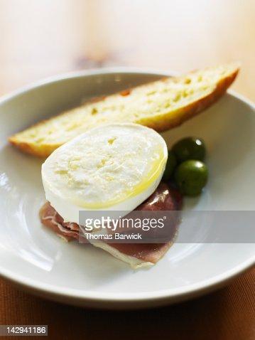 Buffalo mozzarella, prosciutto and olives : Stock Photo
