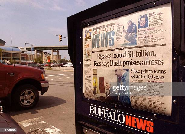 Buffalo News box displays the Rigas family making headlines July 25 2002 in Buffalo New York The Buffalo Sabres hockey team's status is in question...