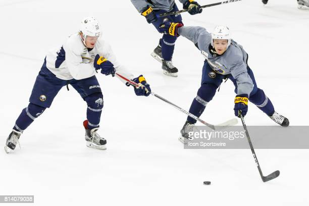 Buffalo Sabres Center Casey Mittelstadt and Buffalo Sabres Left Wing Alexander Nylander fight for puck during the French Connection Tournament at the...