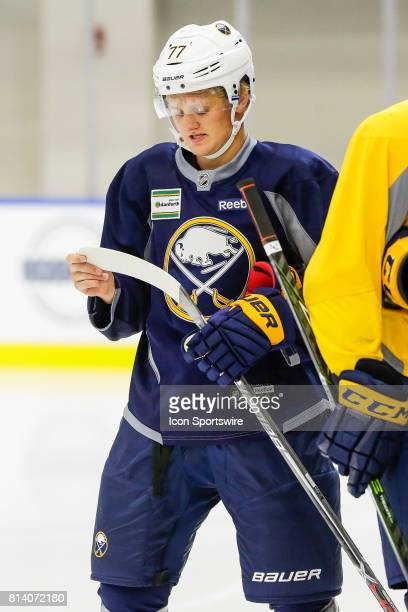 Buffalo Sabres Center Casey Mittelstadt looks at his stick prior to onice practice at the Buffalo Sabres Development Camp on July 10 at HarborCenter...