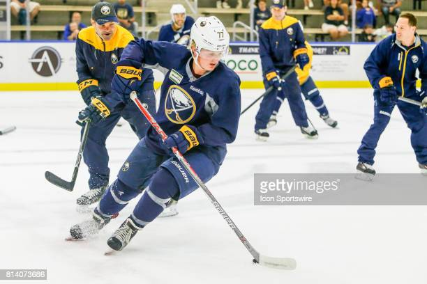Buffalo Sabres Center Casey Mittelstadt skates with the puck as coach approaches during onice practice at the Buffalo Sabres Development Camp on July...