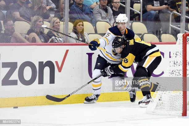 Buffalo Sabres center Jack Eichel is checked off the puck by Pittsburgh Penguins defenseman Brian Dumoulin during the third period in the NHL...