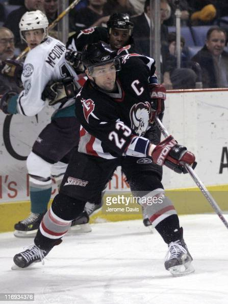 Buffalo Sabres' Chris Drury passes the puck in front of the net during a game versus the Anaheim Mighty Ducks at the HSBC Arena in Buffalo New York...