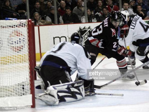 Buffalo Sabres' Chris Drury skates in on Tampa Bays' goalie Sean Burke during a game versus the Tampa Bay Lightning at the HSBC Arena in Buffalo New...
