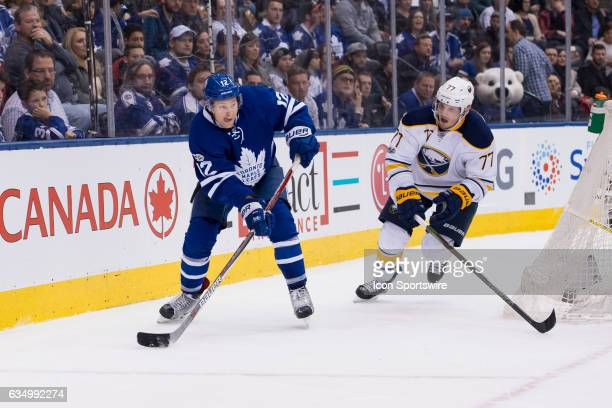 Buffalo Sabres Defenceman Dmitry Kulikov tries to stop a pass from Toronto Maple Leafs Right Wing Connor Brown during the NHL regular season game...