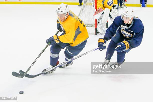 Buffalo Sabres Defenseman Austin Osmanski and Buffalo Sabres Left Wing CJ Smith fight for puck during practice game at the Buffalo Sabres Development...