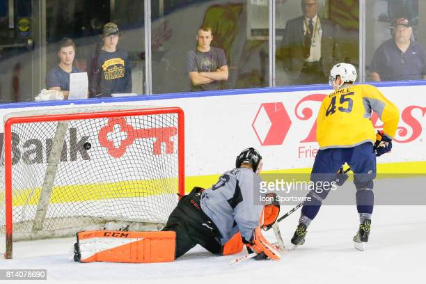 Buffalo Sabres Defenseman Brendan Guhle scores goal past Buffalo Sabres Goalie UkkoPekka Luukkonen during the French Connection Tournament at the...