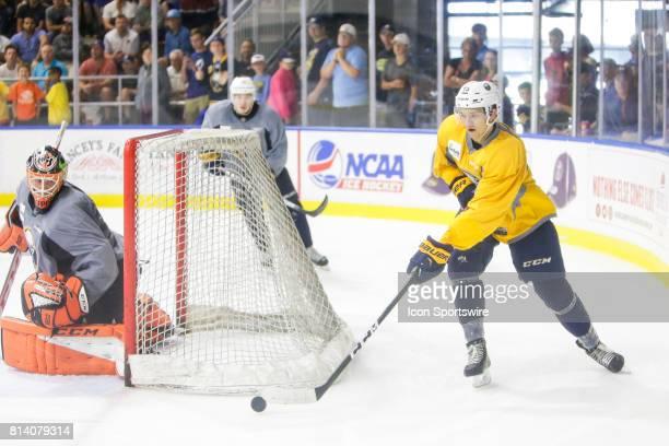 Buffalo Sabres Defenseman Brendan Guhle skates behind opponent's net as Buffalo Sabres Goalie UkkoPekka Luukkonen looks on during the French...