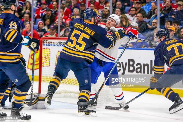 Buffalo Sabres Defenseman Rasmus Ristolainen cross checks Montreal Canadiens Right Wing Brendan Gallagher during the Montreal Canadiens and Buffalo...