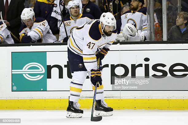 Buffalo Sabres defenseman Zach Bogosian gets set for the draw in the offensive zone during a regular season NHL game between the Boston Bruins and...