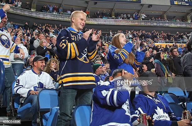 Buffalo Sabres fans celebrate a second period goal as fans of the Toronto Maple Leafs react on November 15 2014 at the First Niagara Center in...