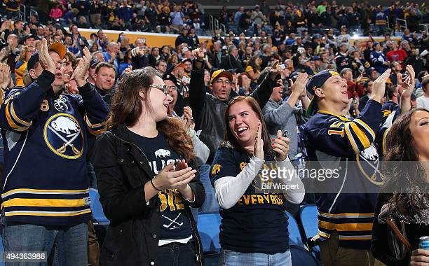 Buffalo Sabres fans cheer a goal against the Toronto Maple Leafs during an NHL game on October 21 2015 at the First Niagara Center in Buffalo New York