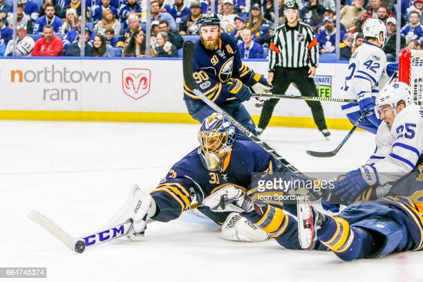Buffalo Sabres Goalie Anders Nilsson dives to clear puck as Toronto Maple Leafs Left Wing James van Riemsdyk looks for rebound and Buffalo Sabres...