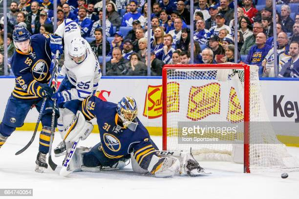 Buffalo Sabres Goalie Anders Nilsson stretches to make save as Buffalo Sabres Defenseman Rasmus Ristolainen and Toronto Maple Leafs Left Wing James...