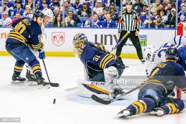 Buffalo Sabres Goalie Anders Nilsson tracks loose puck in front of Sabres goal during the Toronto Maple Leafs and Buffalo Sabres NHL game on April 3...