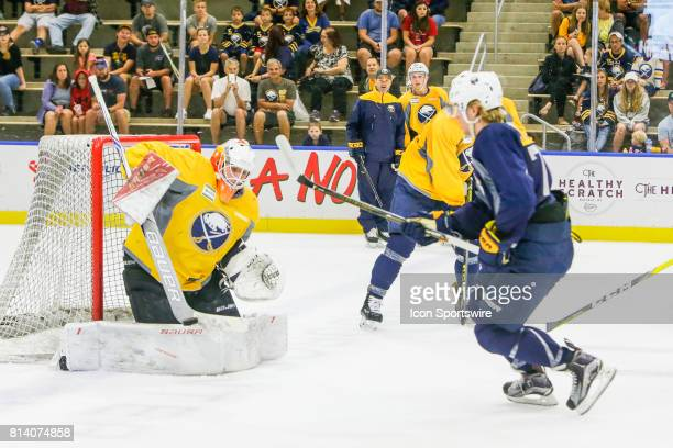 Buffalo Sabres Goalie Jonas Johansson makes save on shot by Buffalo Sabres Left Wing Alexander Nylander during practice game at the Buffalo Sabres...