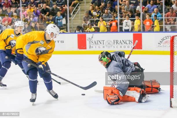 Buffalo Sabres Goalie UkkoPekka Luukkonen prepares to make save on shot by Buffalo Sabres Defenseman Brendan Guhle during the French Connection...