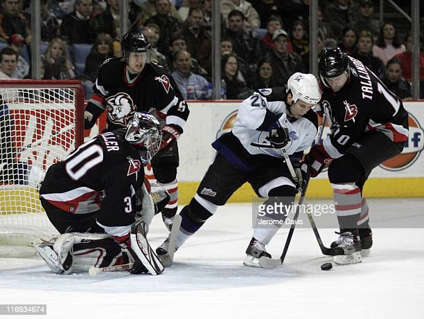 Buffalo Sabres' Henrik Tallinder checks Tampa Bay's Martin St Louis during a game versus the Tampa Bay Lightning at the HSBC Arena in Buffalo New...