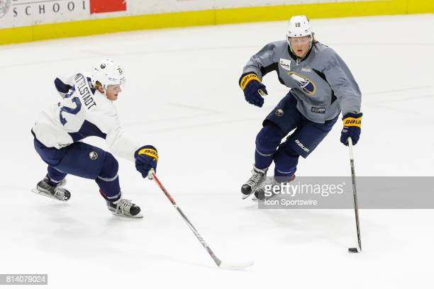 Buffalo Sabres Left Wing Alexander Nylander stick handles past Buffalo Sabres Center Casey Mittelstadt during the French Connection Tournament at the...
