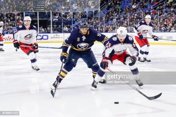 Buffalo Sabres Left Wing Evander Kane and Columbus Blue Jackets Defenseman Markus Nutivaara close in on puck during the Columbus Blue Jackets and...