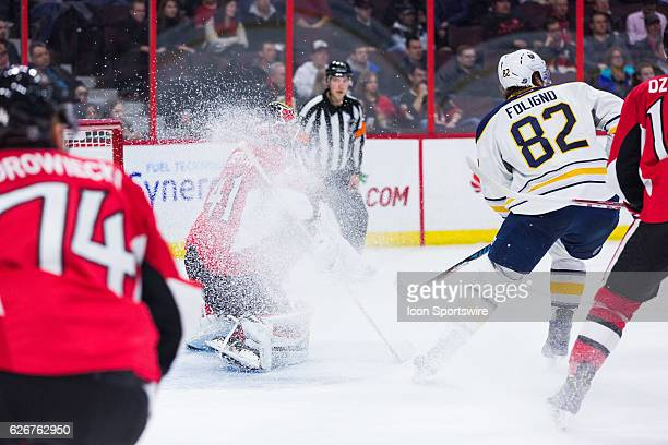 Buffalo Sabres Left Wing Marcus Foligno showers Ottawa Senators Goalie Craig Anderson with ice and snow during third period National Hockey League...