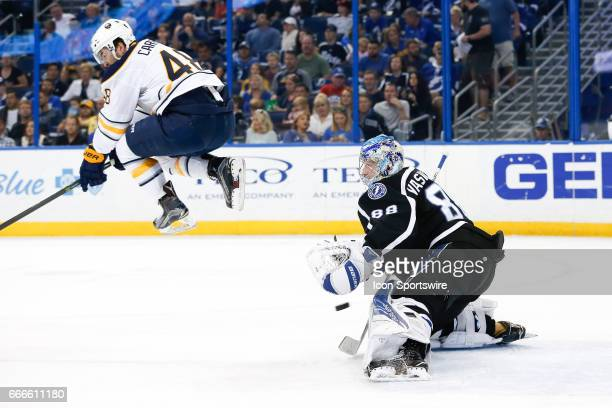 Buffalo Sabres left wing William Carrier jumps to avoid the shot on Tampa Bay Lightning goalie Andrei Vasilevskiy in the 1st period of the NHL game...