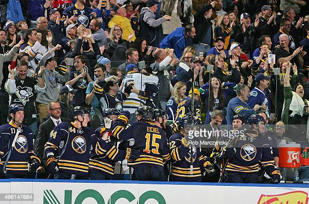 Buffalo Sabres players and fans celebrate after Rasmus Ristolainen scored the game winning goal against the Vancouver Canucks during an NHL game on...
