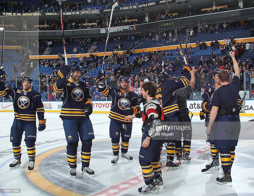 Buffalo Sabres players salute the crowd after a 4-3 shootout victory over the Montreal Canadiens on February 7, 2013 at the First Niagara Center in Buffalo, New York.