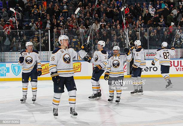 Buffalo Sabres players salute the crowd after their 41 victory against Washington Capitals in an NHL game on January 16 2016 at the First Niagara...