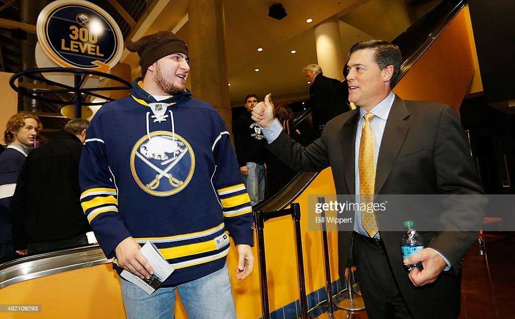 Buffalo Sabres President of Hockey Operations, Pat LaFontaine, greets a fan before a game against the Toronto Maple Leafs on November 15, 2013 at the First Niagara Center in Buffalo, New York.