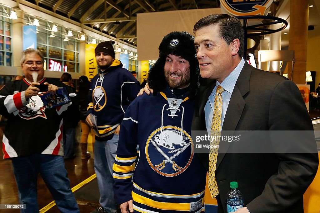 Buffalo Sabres President of Hockey Operations Pat LaFontaine poses for a photo with Chris Lombard of Cheektowaga, NY before the Sabres game against the Toronto Maple Leafs on November 15, 2013 at the First Niagara Center in Buffalo, New York.