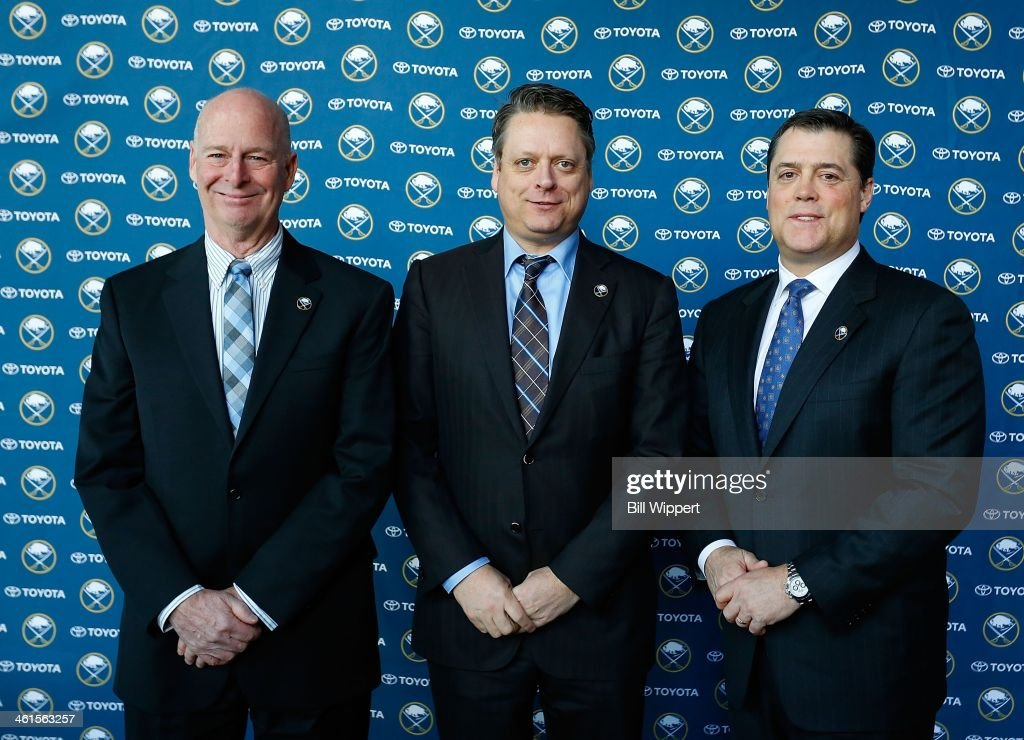 Buffalo Sabres president of hockey operations <a gi-track='captionPersonalityLinkClicked' href=/galleries/search?phrase=Pat+LaFontaine&family=editorial&specificpeople=213982 ng-click='$event.stopPropagation()'>Pat LaFontaine</a> (R) welcomes special assistant and advisor to the hockey department Craig Patrick (L) and general manager Tim Murray (C) at a media conference on January 9, 2014 at the First Niagara Center in Buffalo, New York.