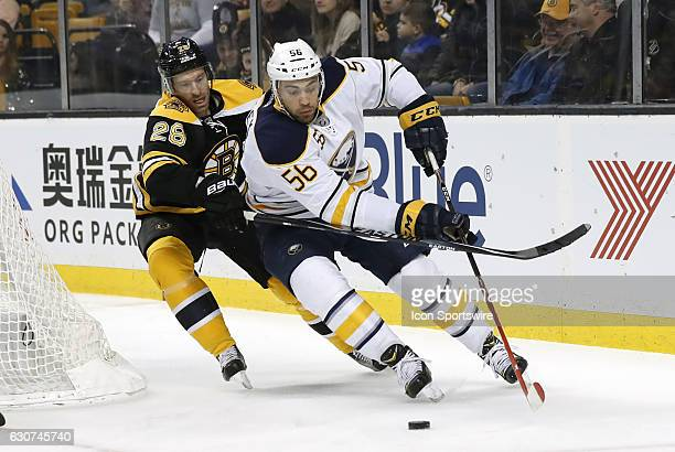 Buffalo Sabres right wing Justin Bailey chased Boston Bruins center Dominic Moore during a regular season NHL game between the Boston Bruins and the...