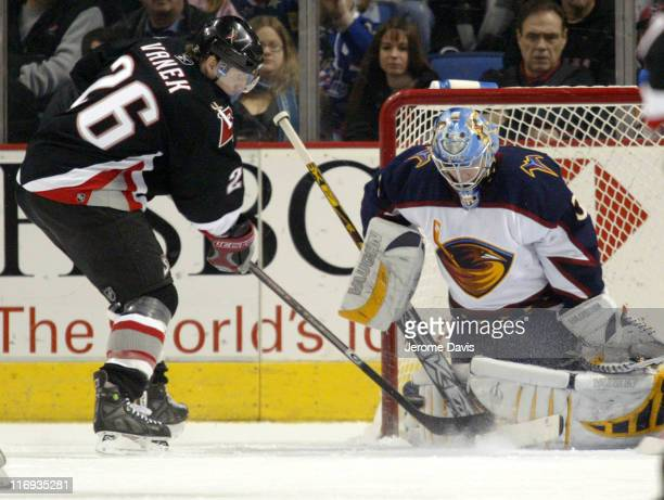 Buffalo Sabres' Thomas Vanek is stopped by Atlanta Thrashers' goalie Kari Lehtonen during a game at the HSBC Arena in Buffalo NY March 1 2006 Atlanta...