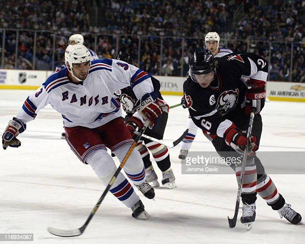 Buffalo Sabres' Thomas Vanek tries to go around Rangers Michal Rozsival during a game against the New York Rangers at the HSBC Arena in Buffalo NY...