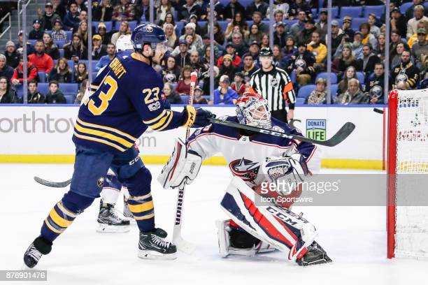 Buffalo Sabres Winger Sam Reinhart and Columbus Blue Jackets Goalie Sergei Bobrovsky track puck during the Columbus Blue Jackets and Buffalo Sabres...