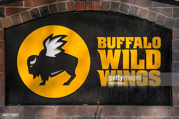 Buffalo Wild Wings Inc signage is displayed outside of a restaurant in San Ramon California US on Thursday Jan 23 2014 Buffalo Wild Wings Inc is...